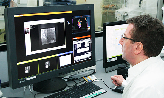 "Prof. Dr. Christian Butter in front of an EIZO RadiForce RX440 (4 MP, 30"" diagnosis monitor) in the HKL3 laboratory."
