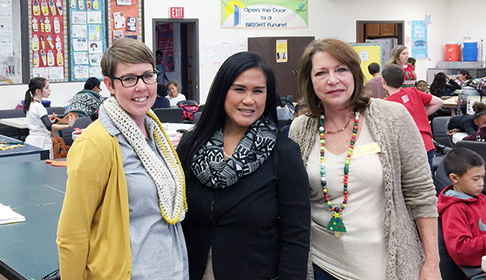 EIZO staff member (center) with staff of the Cypress Boys & Girls Club