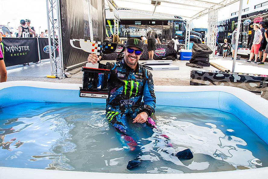 After enduring cockpit temperatures of 140º F in the racecar, Ken Block takes his trophy straight to his kids' pool at the team service area after GRC Round 3 in Daytona, Florida.