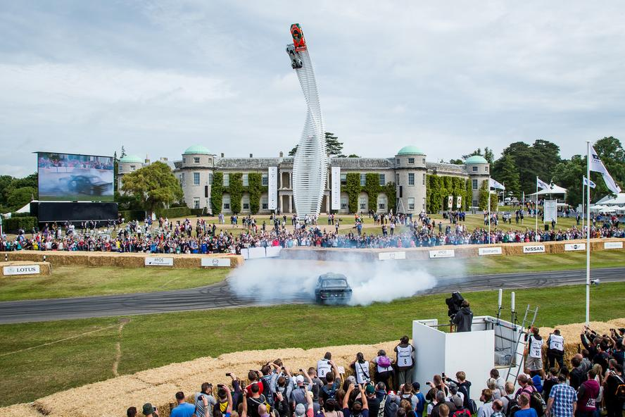 Ken Block performs donuts in his Hoonicorn RTR on the Goodwood Estate grounds at Goodwood Festival of Speed 2015