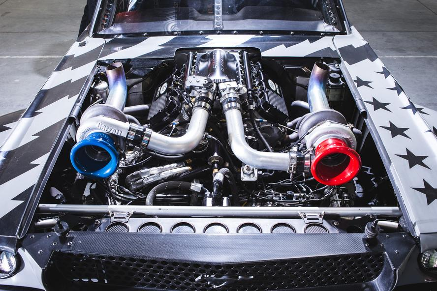 Just when you thought that one of the most iconic custom car builds of the last decade couldn't get any better, Ken Block and Hoonigan have gone and improved upon the perfection that was Block's 1965 Ford Mustang Hoonicorn RTR from Gymkhana SEVEN. How you ask? By adding two turbos to the equation and adding methanol.
